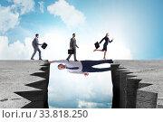 Купить «Businessman acting as a bridge in support concept», фото № 33818250, снято 27 мая 2020 г. (c) Elnur / Фотобанк Лори