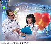 Купить «Telemedicine concept with remote monitoring of heart condition», фото № 33818270, снято 27 мая 2020 г. (c) Elnur / Фотобанк Лори