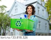 Купить «smiling young woman sorting plastic waste outdoors», фото № 33818326, снято 18 апреля 2020 г. (c) Syda Productions / Фотобанк Лори