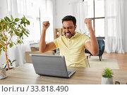 Купить «indian man with laptop working at home office», фото № 33818490, снято 4 апреля 2020 г. (c) Syda Productions / Фотобанк Лори