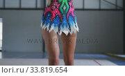 Купить «Female gymnast performing at sports hall», видеоролик № 33819654, снято 17 сентября 2019 г. (c) Wavebreak Media / Фотобанк Лори