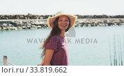 Купить «Side view of a teenage Caucasian girl lokking at camera near the sea», видеоролик № 33819662, снято 4 февраля 2020 г. (c) Wavebreak Media / Фотобанк Лори