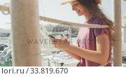 Купить «Side view of a teenage Caucasian girl using her phone harbor side», видеоролик № 33819670, снято 4 февраля 2020 г. (c) Wavebreak Media / Фотобанк Лори