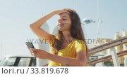 Купить «Side view of a teenage Caucasian girl enjoying her time on a boat and using her phone», видеоролик № 33819678, снято 4 февраля 2020 г. (c) Wavebreak Media / Фотобанк Лори