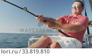 Купить «Front view of a Caucasian man fishing on boat», видеоролик № 33819810, снято 4 февраля 2020 г. (c) Wavebreak Media / Фотобанк Лори