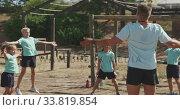 Купить «Group of Caucasian children training at boot camp », видеоролик № 33819854, снято 7 февраля 2020 г. (c) Wavebreak Media / Фотобанк Лори