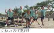 Group of Caucasian children training at boot camp . Стоковое видео, агентство Wavebreak Media / Фотобанк Лори