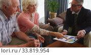 Купить «Senior couple talking with a business man in retirement house», видеоролик № 33819954, снято 22 ноября 2018 г. (c) Wavebreak Media / Фотобанк Лори