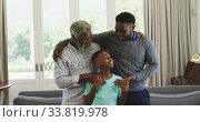 Купить «Mixed race man spending time with his father and his son», видеоролик № 33819978, снято 19 февраля 2020 г. (c) Wavebreak Media / Фотобанк Лори
