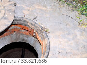 Купить «Concrete cesspit with an open hatch on the ground in the summer.», фото № 33821686, снято 30 мая 2020 г. (c) age Fotostock / Фотобанк Лори