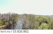 Купить «View of dirty river between the field with trees», видеоролик № 33826862, снято 2 июня 2020 г. (c) Константин Шишкин / Фотобанк Лори