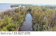 Купить «View of dirty river between the field with different trees», видеоролик № 33827070, снято 2 июня 2020 г. (c) Константин Шишкин / Фотобанк Лори