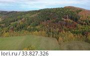 Купить «Panoramic countryside autumn view of hills and fields», видеоролик № 33827326, снято 19 октября 2019 г. (c) Яков Филимонов / Фотобанк Лори