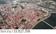 Купить «Panoramic aerial view of Pontevedra with view of buildings and sea bay, Spain», видеоролик № 33827398, снято 18 июня 2019 г. (c) Яков Филимонов / Фотобанк Лори