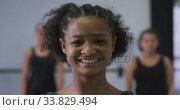 Купить «Portrait of a mixed race modern female dancer looking at the camera», видеоролик № 33829494, снято 4 декабря 2019 г. (c) Wavebreak Media / Фотобанк Лори
