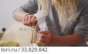 Купить «A Caucasian male surfboard maker polishing a wooden surfboard edge», видеоролик № 33829842, снято 6 марта 2020 г. (c) Wavebreak Media / Фотобанк Лори