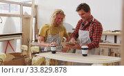 Купить «Two Caucasian male surfboard makers standing and working on projects using a tablet», видеоролик № 33829878, снято 6 марта 2020 г. (c) Wavebreak Media / Фотобанк Лори