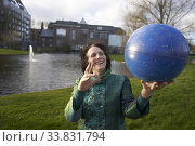 Купить «Woman with astrological star map globe. Leeuwarden, Netherlands.», фото № 33831794, снято 1 марта 2020 г. (c) age Fotostock / Фотобанк Лори