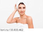 Купить «Beauty and Skin care concept - Beautiful caucasian Young Woman with bath towel on head covering her breasts, on white», фото № 33833462, снято 5 июня 2020 г. (c) easy Fotostock / Фотобанк Лори