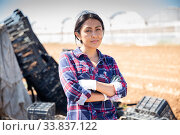 Купить «Portrait of successful latin american female farmer in the backyard», фото № 33837122, снято 27 мая 2020 г. (c) Яков Филимонов / Фотобанк Лори
