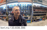 Купить «Ufa, Russia - July 29, 2014: A man is shopping in the Hardware department of the Castorama shop», видеоролик № 33838386, снято 29 июля 2014 г. (c) Mikhail Erguine / Фотобанк Лори