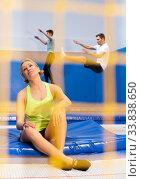 Купить «Tired female gymnast resting on trampoline», фото № 33838650, снято 15 июля 2020 г. (c) Яков Филимонов / Фотобанк Лори