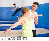 Купить «Trampoline coach training woman», фото № 33838670, снято 1 февраля 2020 г. (c) Яков Филимонов / Фотобанк Лори