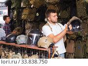 Купить «Men choosing helmet», фото № 33838750, снято 4 июля 2017 г. (c) Яков Филимонов / Фотобанк Лори