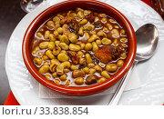 Купить «Top view of Catalan stewed beans with butifarra sausage», фото № 33838854, снято 26 мая 2020 г. (c) Яков Филимонов / Фотобанк Лори