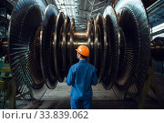 Worker checks turbine impeller vanes on factory. Стоковое фото, фотограф Tryapitsyn Sergiy / Фотобанк Лори
