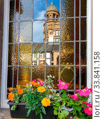 Купить «Reflection of an old classical building in the window of another classical building with a flower-pot in the foreground. Shot in Manchester, UK.», фото № 33841158, снято 10 июля 2020 г. (c) easy Fotostock / Фотобанк Лори