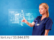 Купить «Doctor touching blue screen with full body analyze concept», фото № 33844870, снято 9 июля 2020 г. (c) easy Fotostock / Фотобанк Лори