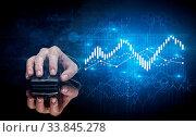 Купить «Hand using wireless mouse with statistical concept on dark background», фото № 33845278, снято 5 августа 2020 г. (c) easy Fotostock / Фотобанк Лори