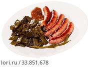 Купить «Fried sausages served with green beans at plate», фото № 33851678, снято 31 мая 2020 г. (c) Яков Филимонов / Фотобанк Лори