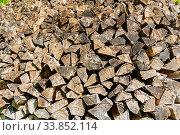 Купить «Дрова, поленница. Wooden background - pile of stacked firewood prepared for fireplace and boiler», фото № 33852114, снято 12 мая 2018 г. (c) Зезелина Марина / Фотобанк Лори