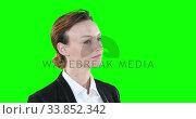 Profile of a Caucasian woman on green background. Стоковое видео, агентство Wavebreak Media / Фотобанк Лори