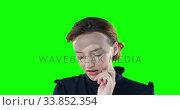 Купить «Worried Caucasian woman on green background», видеоролик № 33852354, снято 8 августа 2017 г. (c) Wavebreak Media / Фотобанк Лори