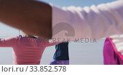 Купить «Multi-ethnic group of women doing yoga position on the beach and blue sky background», видеоролик № 33852578, снято 15 октября 2019 г. (c) Wavebreak Media / Фотобанк Лори