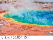 Купить «Inspiring natural background. Pools and geysers fields in Yellowstone National Park, USA.», фото № 33854154, снято 2 июня 2020 г. (c) easy Fotostock / Фотобанк Лори