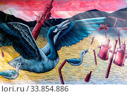 Cordoba Argentina December 21 this mural located in Southern Cordoba, represents the revenge of nature against human activities. Cordoba Argentina December 21, 2019. Стоковое фото, фотограф Zoonar.com/Mark Pitt Images / easy Fotostock / Фотобанк Лори