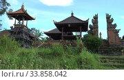 Купить «Panorama of the old local village Temple standing among farmers fields on a summer sunny day, Bali, Indonesia , Shot in 4K UHD», видеоролик № 33858042, снято 2 июня 2009 г. (c) Куликов Константин / Фотобанк Лори