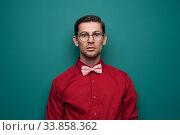 Купить «Close-up portrait of young man in glasses and tie-bow», фото № 33858362, снято 10 марта 2019 г. (c) Pavel Biryukov / Фотобанк Лори