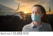Woman wearing face mask at airport. Стоковое фото, фотограф Сергей Петерман / Фотобанк Лори