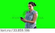 Купить «Animation of a Caucasian woman in suit using a phone in a green background», видеоролик № 33859186, снято 24 октября 2018 г. (c) Wavebreak Media / Фотобанк Лори