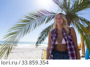 Купить «Caucasian woman enjoying time at the beach», фото № 33859354, снято 25 февраля 2020 г. (c) Wavebreak Media / Фотобанк Лори