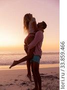 Купить «Caucasian couple enjoying time at the beach during the sunset», фото № 33859466, снято 25 февраля 2020 г. (c) Wavebreak Media / Фотобанк Лори