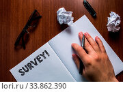 Купить «Writing note showing Survey. Business concept for research method used for collecting data from a predefined group Man hand resting pen open notebook reading glasses lying wooden table», фото № 33862390, снято 6 июня 2020 г. (c) easy Fotostock / Фотобанк Лори