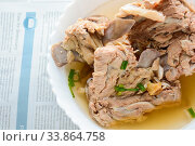 Купить «Slow Cooker Pork Bone Broth, it's simmered for many hours to extract as much nutrients from it. The long cooking time breaks down bone to release vitamins, collagen, nutrients are good for us.», фото № 33864758, снято 10 июля 2020 г. (c) easy Fotostock / Фотобанк Лори