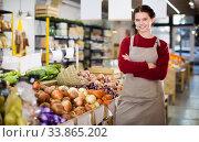 Купить «Young girl selling onion and smiling», фото № 33865202, снято 1 марта 2017 г. (c) Яков Филимонов / Фотобанк Лори