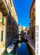 Купить «Venice cityscape with narrow canal», фото № 33865226, снято 5 сентября 2019 г. (c) Яков Филимонов / Фотобанк Лори